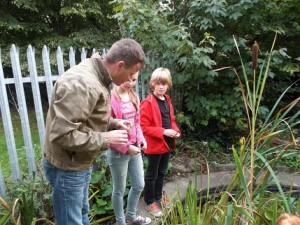 Garden committee showing parents the pond area