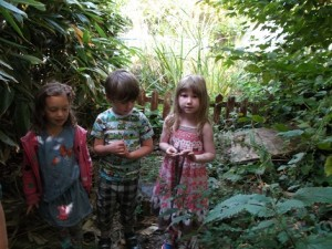 junior infants exploring garden